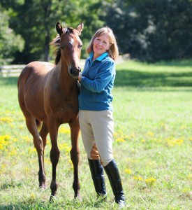 Melanie Smith-Taylor enjoying time with one of her young horses.